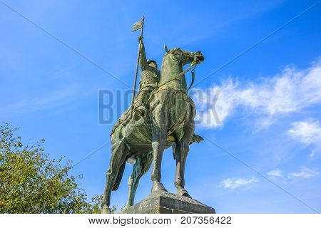 Bottom view of equestrian statue of Vimara Peres in Historic Centre of Porto, Portugal in a sunny day. The statue is located near Cathedral of Oporto or Se do Porto.