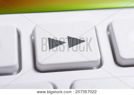 Close Up Of A White Fast Forward Button Of A White Remote Control For A Hifi Stereo Audio System