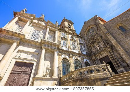 Prospective view of baroque main portal and gothic rose window of main facade of Church of Third Order of St. Francis or Igreja da Ordem Terceira de Sao Francisco. Ribeira district in Porto, Portugal.