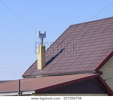 The Roof Of Corrugated Sheet. Brown Corrugated Metal Profile Roof.