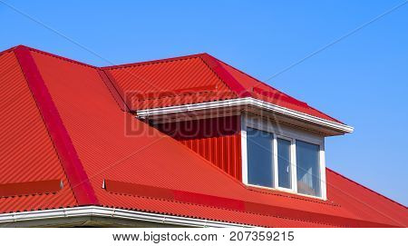 House With Plastic Windows And A Red Roof Of Corrugated Sheet