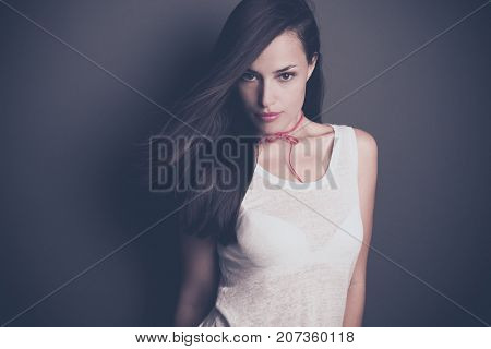 young beautiful dark hair woman portrait in white t-shirt and pink leather choker bow necklace