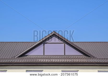 House With Plastic Windows And A Brown Roof Of Corrugated Sheet