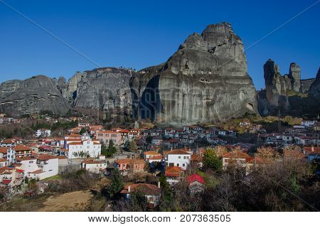 Rock towers of Meteora monasteries on top of them and kastraki village, Greece.
