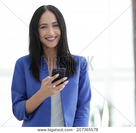Young businesswoman with mobilephone
