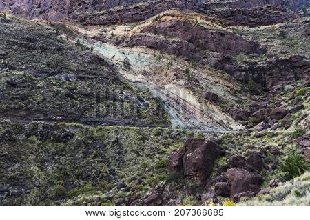 Multicolored sedimentary rock layers. Gran Canaria, Spain.