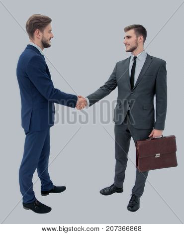 lawyer shaking hands with client welcoming him at the meeting