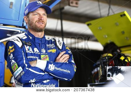 September 30, 2017 - Dover, Delaware, USA: Dale Earnhardt Jr. (88) hangs out in the garage during practice for the Apache Warrior 400 at Dover International Speedway in Dover, Delaware.