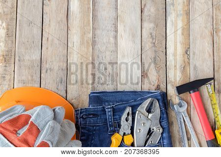Labor Day is a federal holiday of United States America. Repair equipment and many handy tools on wooden talbe background. Top view with copy space for use and design. Business concept.