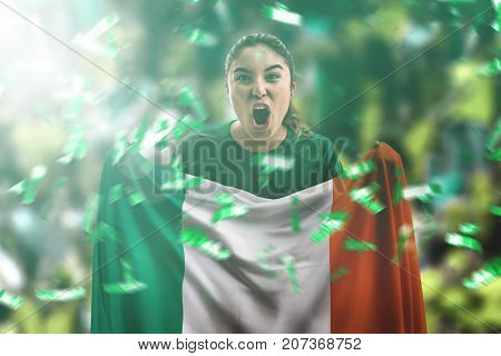 Irish female fan holding the national flag