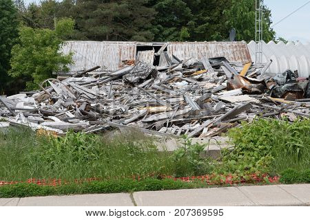 Pile of rubbish timber and steel from demolished house