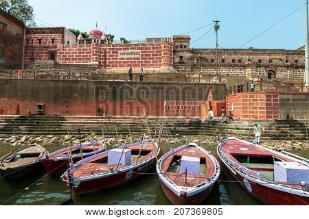 VARANASI INDIA - MARCH 14 2016: Horizontal picture of many boats at Ganges River in front of Chet Singh Ghat in the city of Varanasi in India