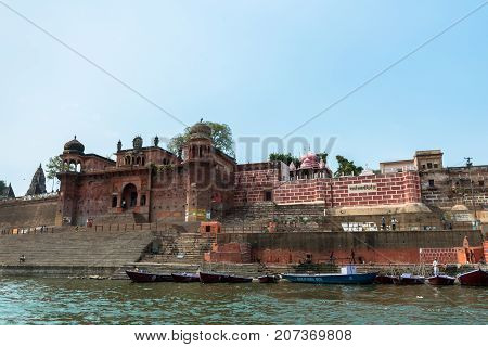 VARANASI INDIA - MARCH 14 2016: Wide angle picture of the amazing architecture of Chet Singh Ghat in front of Ganges River in the city of Varanasi in India