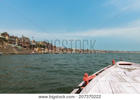 VARANASI INDIA - MARCH 14 2016: From the boat wide angle picture of Ganges River in the city of Varanasi in India