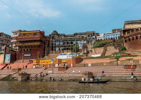 VARANASI INDIA - MARCH 14 2016: Wide angle picture of beautiful houses with nice architecture in front of Ganges River during day time in Varanasi India.