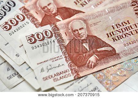 Colorful 500 banknotes of Icelandic krona. Horizontal macro photo.