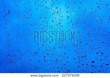 Beautiful Drop Of Rain On Glass Or Windows Surface. Dew Or Raindrop On Glass Surface For Abstract Ba