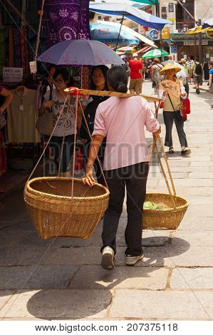 xingping guilin china July 2017: in July tourists travel through the streets of the village to shop and meet local mores and traditions left untouched over time