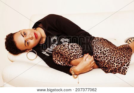 pretty stylish african american big mama woman well dressed. swag relax at home, leopard print on clothers. fashion look