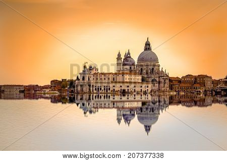 Fine art image with Grand Canal and Basilica Santa Maria della Salute, reflected on the water surface, Venice, Italy.