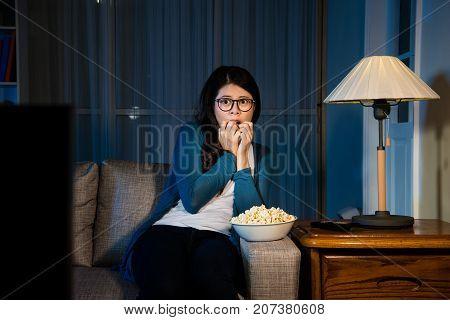 Attractive Sweet Woman Sitting On Comfortable Sofa