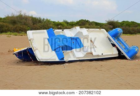 destroys boats on the beach after the hurricane and the marshal