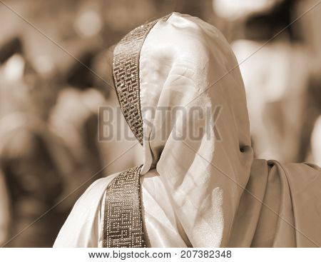 Woman With Veil Over Her Head With Sepia Effect