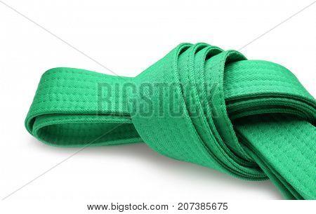 Green karate belt on white background