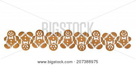 A row of Gingerbread Men cookies isolated on white background border