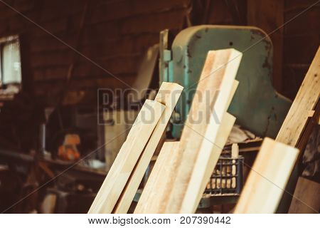 Board products are in the workshop of a carpenter