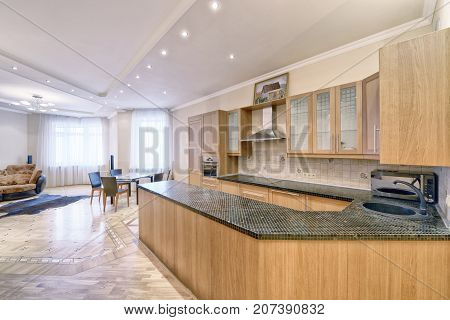 The kitchen is solid wood in a classic style in a modern house.