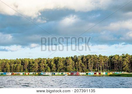 Boat houses on Lielupe river estuary to Baltic sea, Jurmala, Latvia