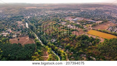 Aerial view on settlement in Eastern Europe in early autumn. Old style color grading.