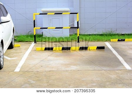 the parking lot space available near white car