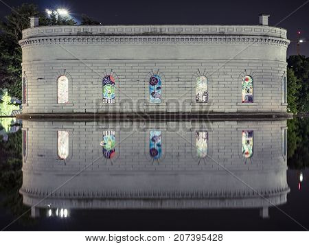 Evening at popular park with monument mirror reflection in water