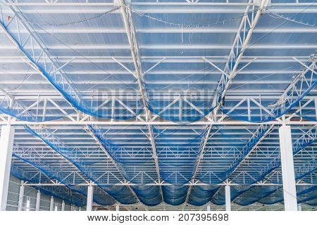 Structure of steel roof frame and metal sheet in building construction site