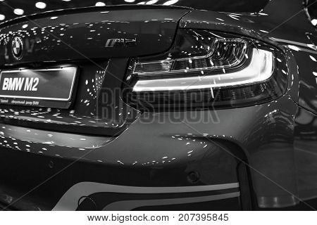 Sankt-Petersburg Russia July 21 2017: Back view of a BMW M2 sports car. M Performance Edition. Car exterior details. Black and white. Photo Taken at Royal Auto Show July 21
