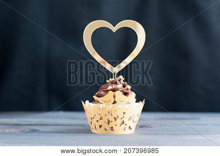 Adorned with gold topper appetizing wedding cupcakes