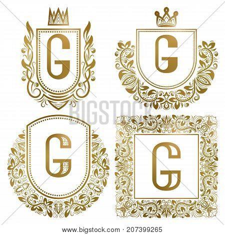 Golden vintage monograms set. Heraldic logos with letter G.
