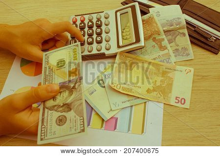 finances currency exchange rate business and people concept - close up of male and female hands giving or exchanging money - Retro color