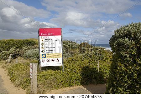 Victoria Parks location and warning sign leading to Gibson's Steps on the Great Ocean Road near the Twelve Apostles Sea Rocks. Dangerous conditions and now swimming.