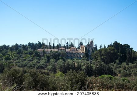 Monastery of Silence and olive grove in the foreground (Latroun, Israel)