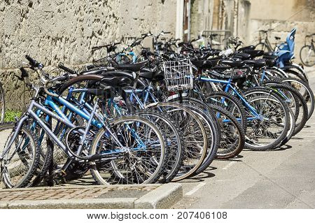 Oxford, UK, May 30, 2010 :  Students bicycles leaning against the wall of a medieval university building