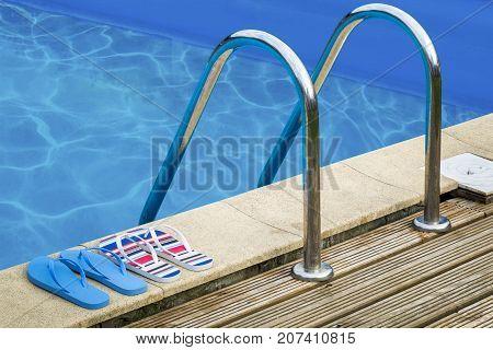 Flip flops and handles at swimming pool