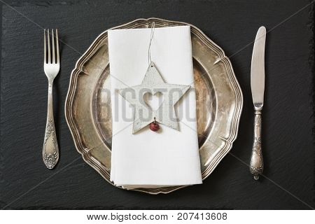 Christmas Table Setting With Vintage Dishware, Silverware And Star Decorations. Top View.