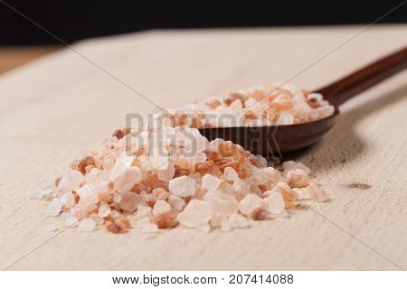 Brown Wood Spoon With Himalayan Salt on wood