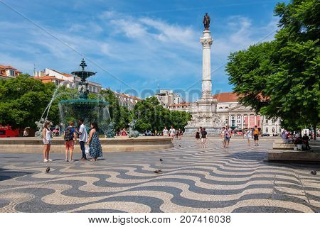 LISBON PORTUGAL - SEPTEMBER 3 2017: The Dom Pedro IV Monument and fountain at Rossio Square in the central Baixa district