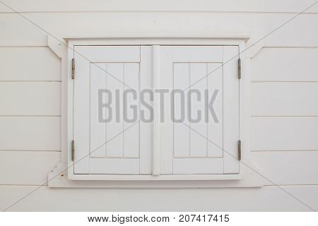 White wooden shutters closed window. Portugal Europa