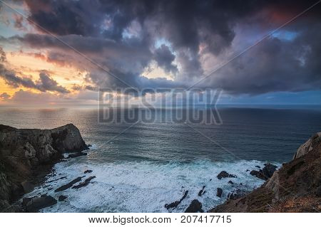 Dramatic seascape of the sunset, on the rocks Costa Vicentina Sagres