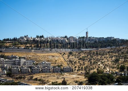 Buildings and houses on the Mount of Olives. Down the hill is the olive grove (Jerusalem, Israel)